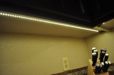 Inspired LED-  Kitchen Under the Cabinet Lighting- LED Ultra Bright Flex Strips, Warm White. A view from underneath the cabinet. Super easy to install yourself! #DIY #lighting #kitchen