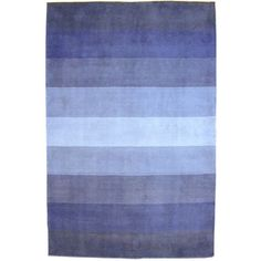 @Overstock - Blue Stripes wool rug adds a pleasant mix of cool blue tones and contemporary design to any decorContemporary rug is hand-tufted of 100-percent woolRug consists of wool yarns on cotton foundations that make it extremely durablehttp://www.overstock.com/Home-Garden/Hand-tufted-Blue-Stripes-Wool-Rug-8-x-10/1171474/product.html?CID=214117 $247.99