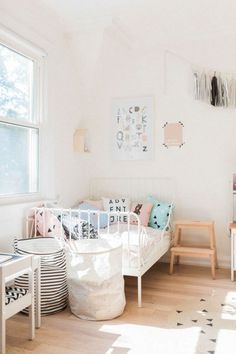 Bedroom in Scandinavian Style Scandinavian shared kids room light-filled pastel baby toddler playroom Ikea Minnen bed House Doctor baskets