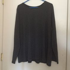 Laura Scott black and silver striped shirt Size 2x Laura Scott black long sleeve shirt with shiny silver stripes. Very good condition, only worn once. Comfortable and relatively light weight. 89% cotton 7% polyester 4% other fiber . The shirt is pretty stretchy. Laura Scott Tops Tees - Long Sleeve