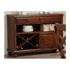 Sunset Trading - Eco-friendly 2-Drawer Buffet Server - Traditional and versatile American farmhouse style. Spacious storage cabinet and wine rack. Two felt lined drawers that glide on European drawer guides. Large spacious open shelf. Warranty: One year. Made from Malaysian oak-cherry veneers board. Chestnut finish. Made in Malaysia. Assembly required. 48 in. W x 17 in. D x 36 in. H (119 lbs.)This beautifully designed server supplied by sunset trading will assure you many years of use and…