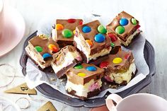 Triple-decker rocky road. Use better recipe but like the tipping colours. Could use red and green for Xmas.