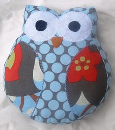 Love the super cute owl pillows I've been seeing everywhere on etsy and DIY sites...of course this one would be cuter if he was done in yellow, grey and white!
