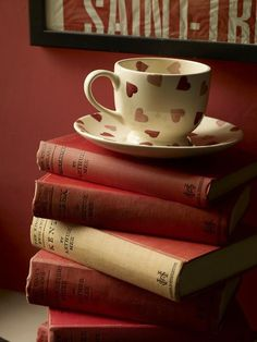 Love the cup and saucer.... a cute display sitting atop a couple books on an end table...