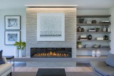 Modern fireplace with textured tile, light strip above and accessorized shelves.