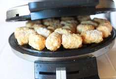 Waffle Iron Hashbrowns!  Put tater tots in the waffle maker and voila!  LOVE this!