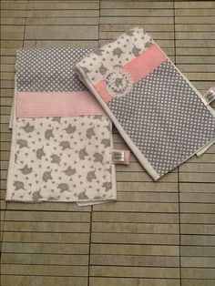$18. Elephant-themed set of two burp cloths in soft flannel and gray and white polka dot cotton. Embellished with pink grosgrain ribbon with shabby chic flowerette on one and a preppy pink pin stripe flannel band on the other. Olivialawsondesigns.etsy.com