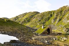 The architecture firm Snohetta created this completely remote cabin in Norway with escaping in mind. Built out of natural elements like rocks and grass, the home is not only secluded, but practically disappears into the landscape.