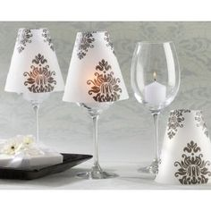 Damask Vellum Shades turn a standard wine glass into a table lamp.  How clever!