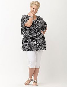 Embrace the versatility and carefree charm of embellished drama sleeve top. Semi-sheer blouse layers beautifully with a loose, flowing fit, beaded V-neck and smocked waist to flatter your curves. Easy to dress up or down, you'll reach for this feminine favorite again and again. lanebryant.com