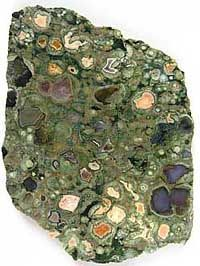 "Rainforest Jasper is a rare type of RHYOLITIC lava that forms when gas bubbles are trapped in a lava flow during solidification. The ""bubbles"" create pockets which are later filled, or partially filled by flows of siliceous material - agate, jasper, quartz crystal or other minerals."