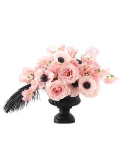 Light pink roses and anemones pop in a black urn in this modern centerpiece