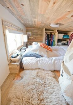 This tiny house has an elevated loft features inbuilt wardrobe space