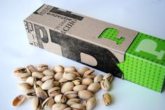 The Pistachio packaging was created in attempt to make a more functional design. The box is not only more visually appealing then a plastic wrapper, it also serves as multiple containers. The lid can be used for discarded shells, while one is eating the pistachios. The materials used to create this package are also economically friendly, seeing as how pistachios are generally a more expensive nut to begin with.