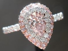 Pink pear diamond ring with double halo