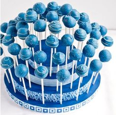Are you looking to jazz up desserts this holiday season? Take a look at the plethora of cake pops we'll be munching on from November to January. Blue Cake Pops, Blue Cakes, Mini Cakes, Cupcake Cakes, Cake Pop Displays, Baby Shower Cake Pops, Shower Bebe, Boy Shower, Salty Cake