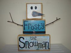 Frosty the Snowman wooden block primitive Christmas decoration for the holidays Christmas carol wooden snowman blue Christmas. $22.00, via Etsy.