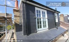Dormer window with french doors and glass balustrade