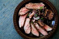 Grilled Flank Steak with Mushrooms Recipe | Simply Recipes  one of the dishes I have made and found delicious from the site.