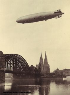 """""""Hindenburg"""" flying above Cologne, my hometown Arrival Your interest in radio controlled product aircraft Old Pictures, Old Photos, Rene Magritte, Cologne Germany, Nature Illustration, Dieselpunk, Steampunk Airship, World's Fair, Ballon"""