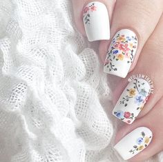 """CLOSE UP for random florals   @colourgossipnails's """"Saved"""" for the white base, and then did the flowers with acrylic paint. Then I used @opi_products's matte top coat! @followthatway"""