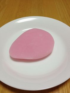 This is Suama(in Japanese; すあま). This is a traditional Japanese confectionery made of rice. It is slightly sweet. This color is a color to mean a celebration. Red and white is a color to mean a celebration in Japan.