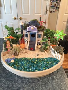 """Beach fairy garden. Just wish I could really live there. This one is for sale $55. """"Down by the sea"""" Mini Gardens, Fairy Gardens, Beach Fairy Garden, Dwarf Plants, Garden Parties, Amazing Gardens, Fantasy, Sea, Table Decorations"""