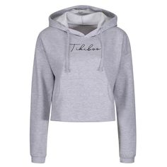 Warm-up or wind down in our super chic grey cropped hoodie with black Tikiboo Essence script logo. Snuggle into this soft cotton-faced top featuring double fabric hood, matching grey drawcords, ribbed cuffs and a front pouch to keep your hands cosy or phone safe.  It's perfect layered over a cross back bra for workouts, co-ordinating effortlessly with our colourful printed leggings. Alternatively, pair with jeans for the ultimate athleisure look. Script Logo, Cropped Hoodie, Printed Leggings, Loungewear, Athleisure, Cosy, Workouts, Cuffs, Pouch