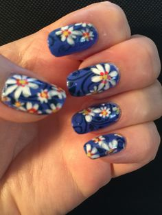 Julie G Cabana Boy, stamped with UC 4-03 and MdU 3 Blue Navy and 7 Dark Green. CISI & SISI 12 and MdU white and 33 light gray. Dotted with China Glaze Coral Star and Pure Ice Show Stopper. Inspired by Robin Moses.