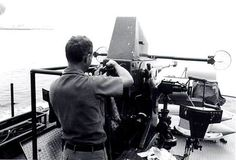 vietnamwarera.com - Conducting maintenance on a 40mm cannon of a PTF (patrol torpedo fast) boat.