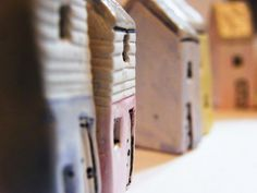 Lovely hand made tiny village cottages from: www.thelittlecottageartco.co.uk these would be delightful grown-ups christmas gifts or stocking fillers