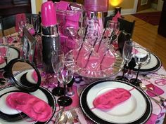 This is a girls party in pink, black and white.  Notice the HUGE lipstick centerpiece, mirrored blush compacts on the plates and everyone has a pink eye mask.  Makes me want to be at the party.