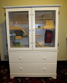 DIY Small Animal Pet Cage; outside view of a small animal cage we fashioned from a secondhand armoire.