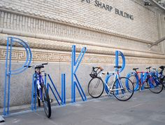 David Byrne's BAM bicycle racks, NYC. Ergonomically selected letters spell out PiNk cRoWN and MicRo LiP