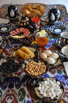 Uzbek Breakfast - must go to Tashkent! (Also, beautiful ikat print under this beautiful food)