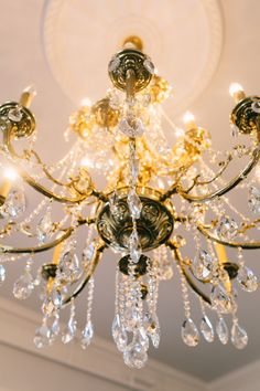 gold + crystal chandelier in parlor room | photo by catherine ann photography | gadsden house | king street hospitality group