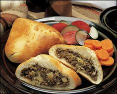 Beerocks - BIerocks A German Favorite. Ground Beef, Cabbage, & Onion baked inside a yeast bread. Goes great with a quality mustard and a cold German brew to wash it down with. I've used ready made Crescent Roll Dough too instead of making my own. Works out fine and is faster for a quick meal.   Recipe: http://www.cooks.com/rec/view/0,1727,131183-251196,00.html