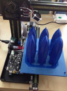 Six copies of an object being 3d printed