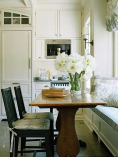 This antique wooden table fits perfectly in this cottage-inspired kitchen. More eat-in kitchens: http://www.bhg.com/kitchen/eat-in-kitchen/eat-in-kitchens/?socsrc=bhgpin063013windowseat=6
