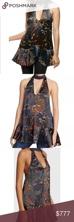 """$128⭐️FREE PEOPLE⭐️ NWT❣️ NWT! Retails $128‼️❣️ Channel the look of your grandma's favorite scarf in this perfectly draped tunic cut with dangling ties and a cool peplum hem. - U-neck - D-ring closure behind neck - Sleeveless - Approx. 35 length (size M) - Imported Fiber Content 65% viscose, 22% nylon, 13% silk Care Hand wash cold, dry flat Additional Info Fit: this style fits true to size. Bust Across: 16"""" Inches  Model's stats for sizing: - Height: 5'8.5"""" - Bust: 34"""" - Waist: 24"""" - Hips…"""