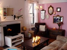 <3 the mirros and coffee table/candles. the pink and covering of the fireplace - not so much.