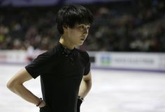 Yuzuru Hanyu of Japan takes a break during a practice session for the World Figure Skating Championships Tuesday, March 12, 2013, in London, Ontario.