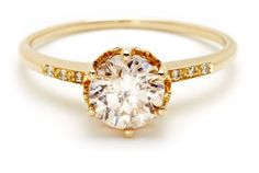 The gorgeous Hazeline ring from Anna Sheffield. One of her most popular styles, the Hazeline solitaire engagement ring is shown in a round brilliant champagne colored diamond set in yellow gold.