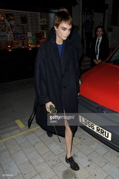 3c7847424d Oversized Outerwear + Closed-Toe Shoes  Cara Delevingne leaving Waterstones  in Piccadilly.