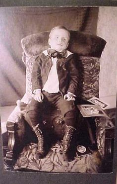 Postmortem photo: Little boy with his toys...