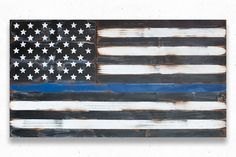 "This Thin Blue Line wood flag has a weathered, vintage look. It has been made to appear aged/antiqued. Flag sizes available: 36x20"" 50x27"" 60x32"" Custom sizes available upon request. This flag is weat"