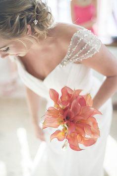 Elegantly unique bright pink wedding bouquet with orang undertone; Featured Photographer: Trish Barker Photography #white #flowers #wedding
