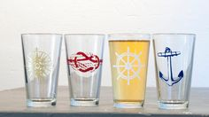 The Nautical set - 4 screen printed pint glasses, gold, burgundy, white and blue. $42.00, via Etsy.