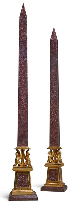 A PAIR OF ITALIAN NEOCLASSICAL GILT BRONZE AND PORPHYRY OBELISKS EARLY 19TH CENTURY |