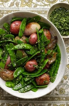 Small russet potatoes, onion halves, green sugar snap peas